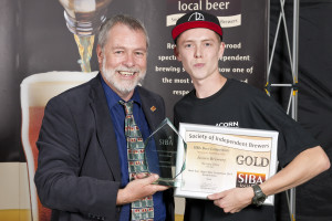 Acorn's assistant brewer Bruce Woodcock receives the gold award for Barnsley Bitter from SIBA chairman Guy Sheppard.