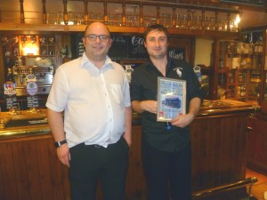John at the Devonshire Cat receives their November Pub of the Month award