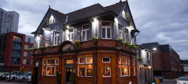 Exterior of pub late evening.